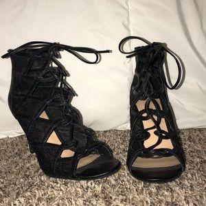 Black lace crossed up heels